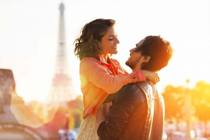 couple hugging by Eiffel Tower