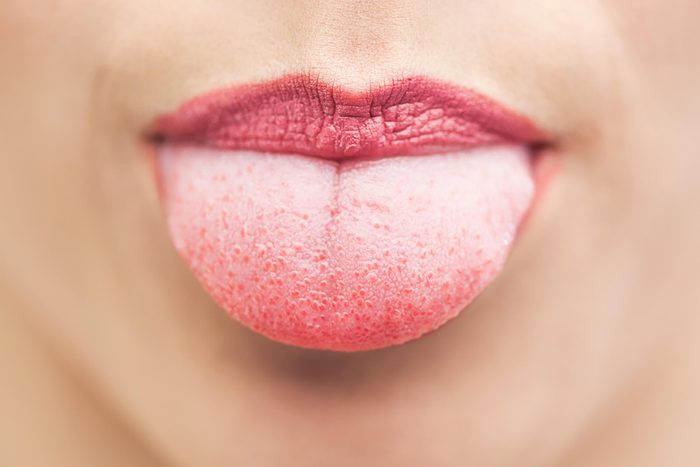 woman sticking out tongue
