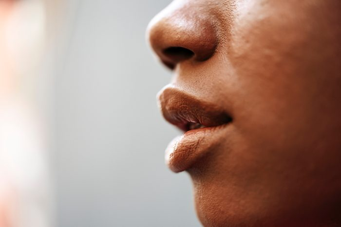 side view cropped shot of woman's lips and nose