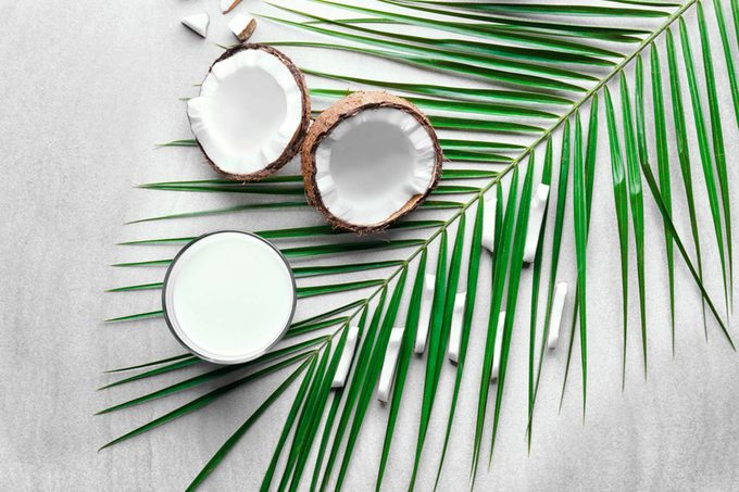 coconut halves with palm frond