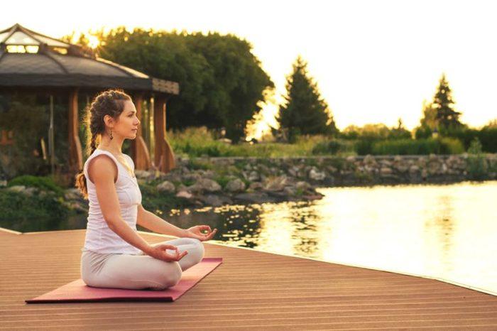 woman meditation on a dock