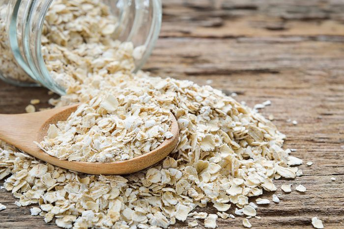 oats in a wooden spoon