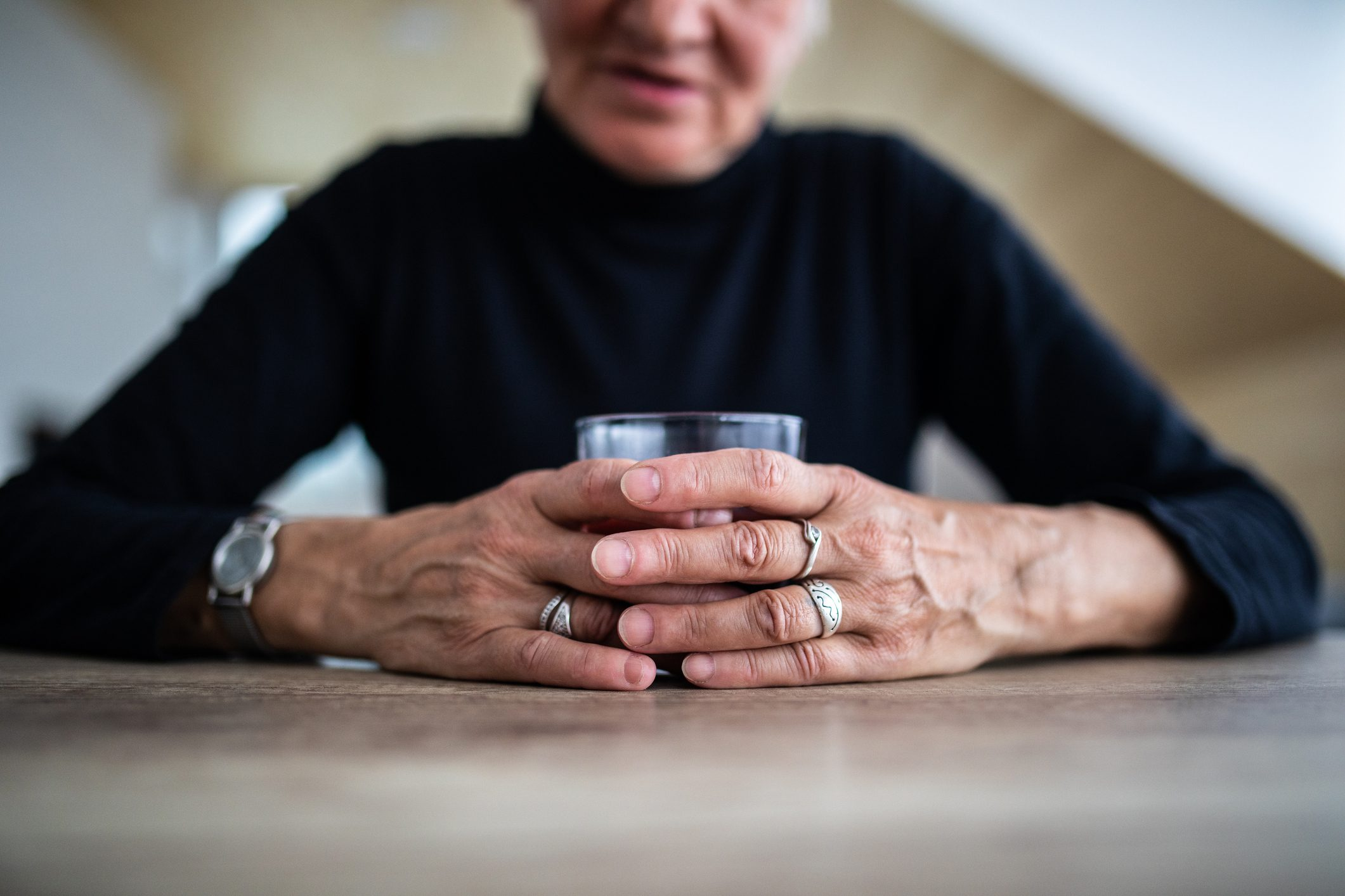 older woman struggling with alcohol addiction