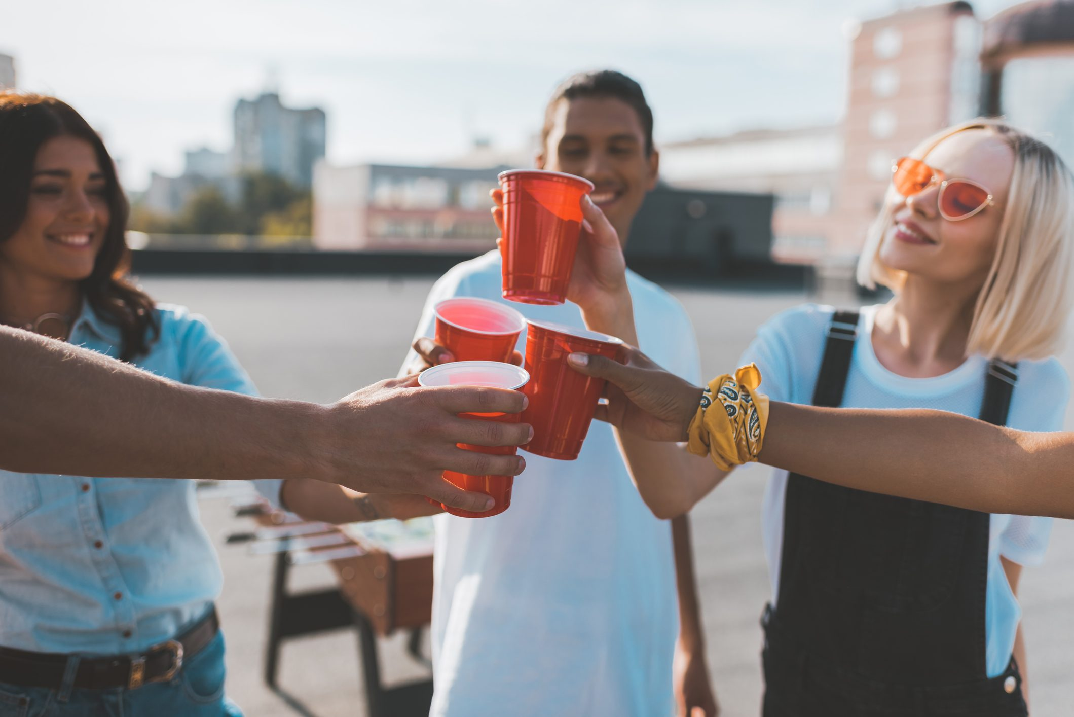 group of young friends drinking together