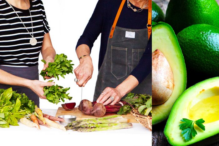 Two women cutting up vegetables