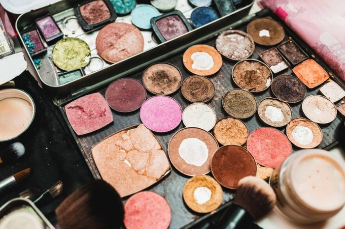 Old makeup powders and bronzers in an old case.