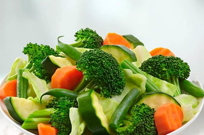 chopped broccoli, carrots, green beans, and zucchini in a white bowl