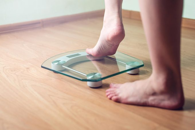 feet stepping on scale