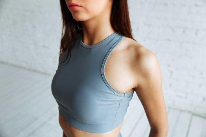 Young woman wearing a sports bra.