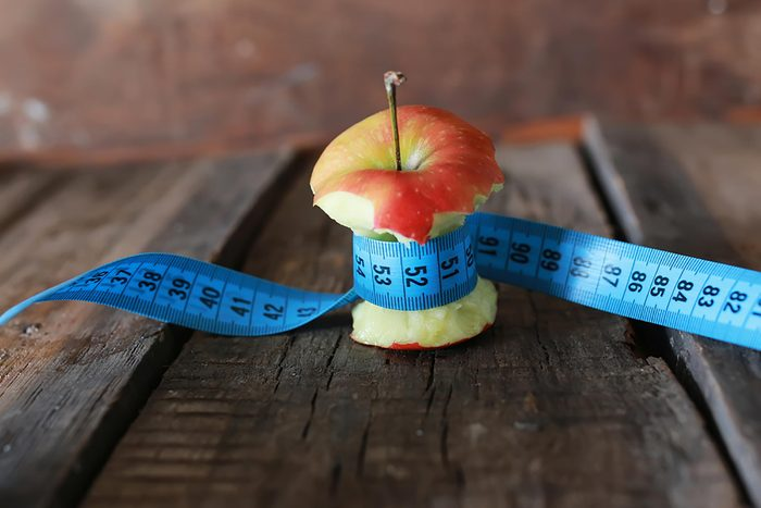 apple core with tape measure