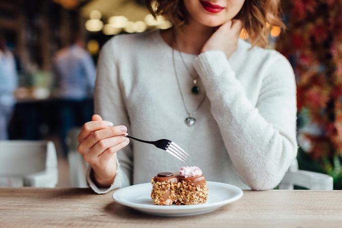 woman eating dessert