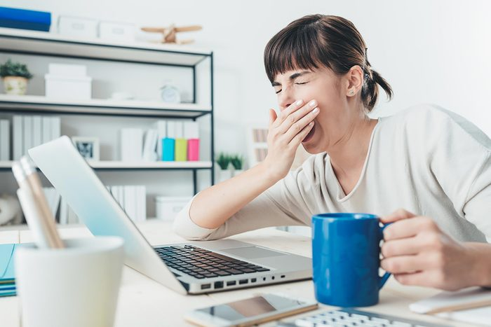 yawning women at computer