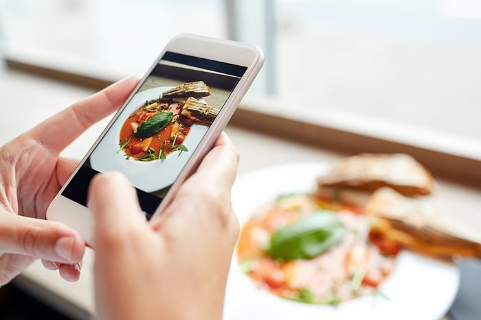 person looking at food on phone