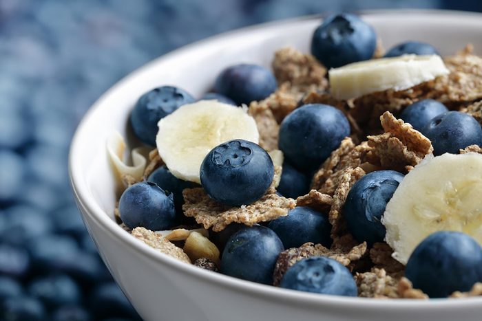bowl of blueberries, bananas, and cereal