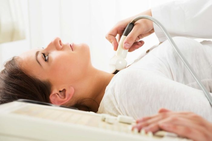 woman getting an ultrasound on her throat