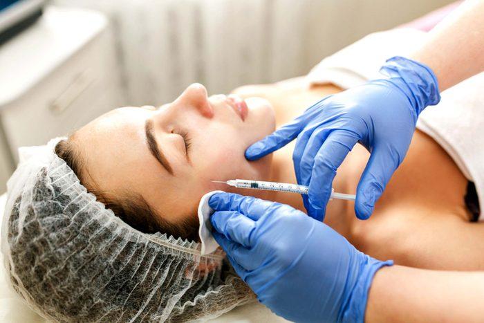 woman having facial injection