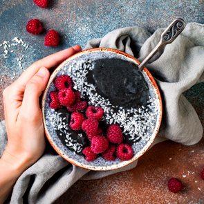 bowl yogurt fruit hand