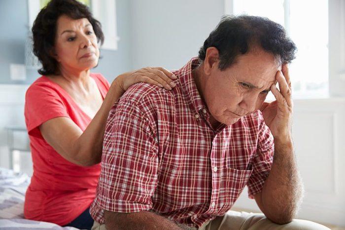 woman comforting worried man