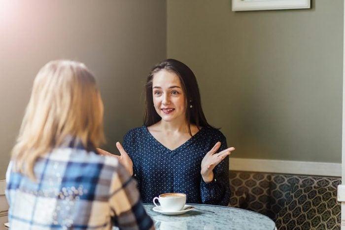 friends having a conversation in a coffee shop
