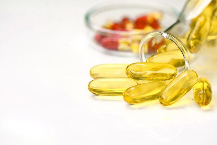 close up of translucent yellow vitamin capsules