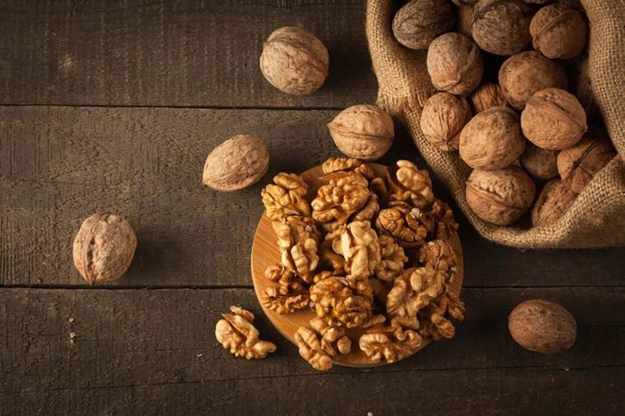 Walnuts shelled and unshelled on a wooden table