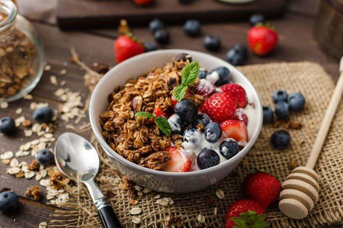 granola, blueberries, and strawberries over Greek yogurt