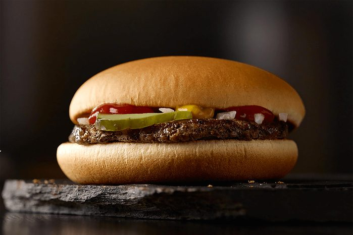 Mcdonald's hamburger on a plate.