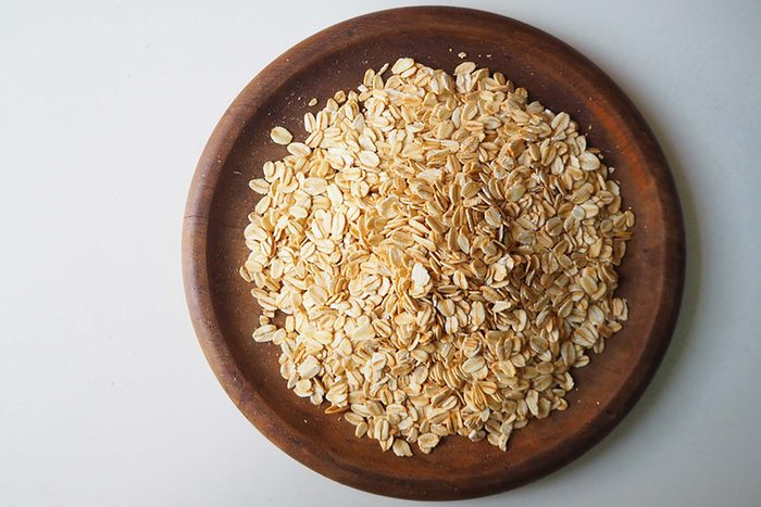 dry Oatmeal on a wooden bowl