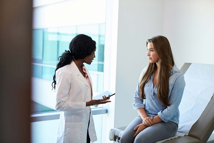 woman doctor speaking to woman patient