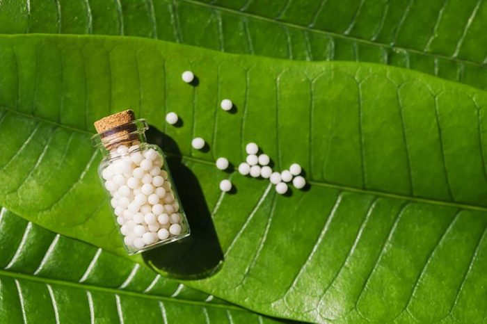 Homeopathy tablets on leaf