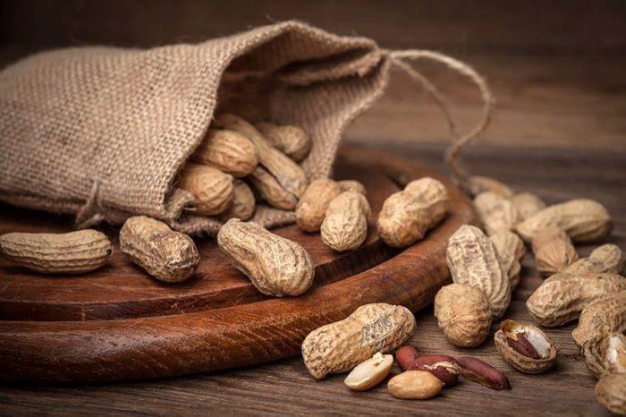 burlap bag full of whole peanuts