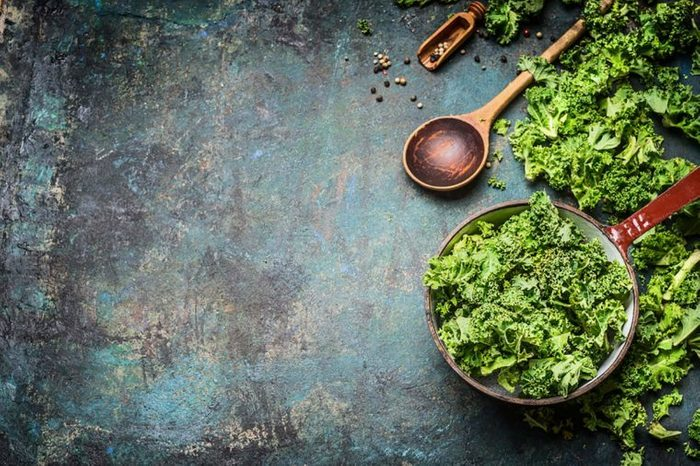 Kale in a bowl and scattered on a slate table