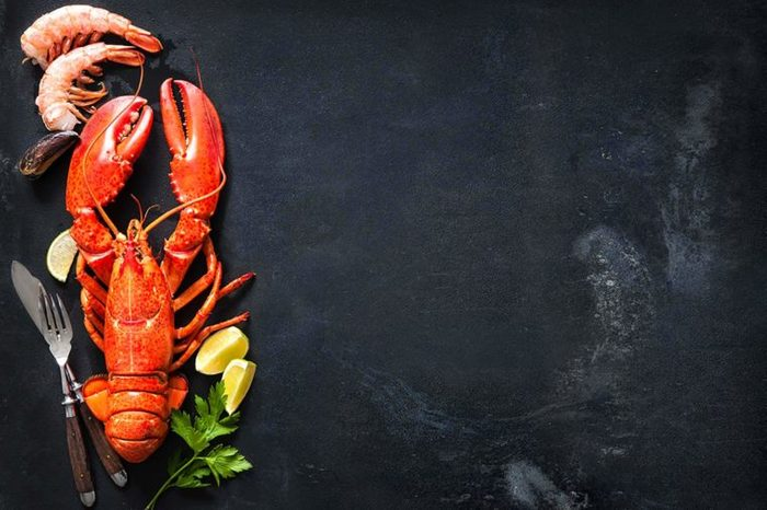Lobster and shrimp and lemon wedges
