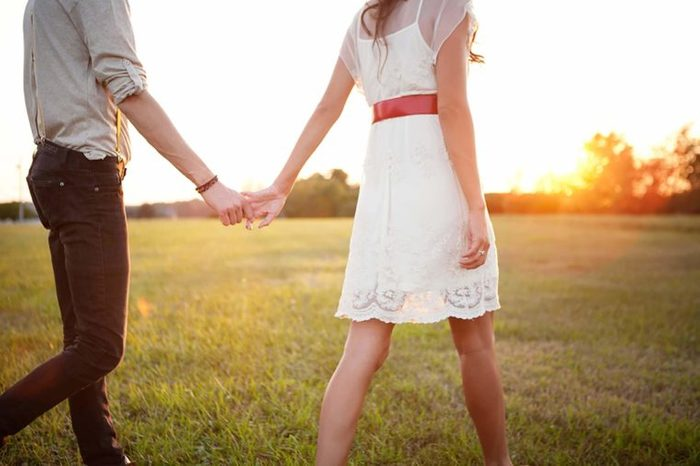 couple holding hands relationship