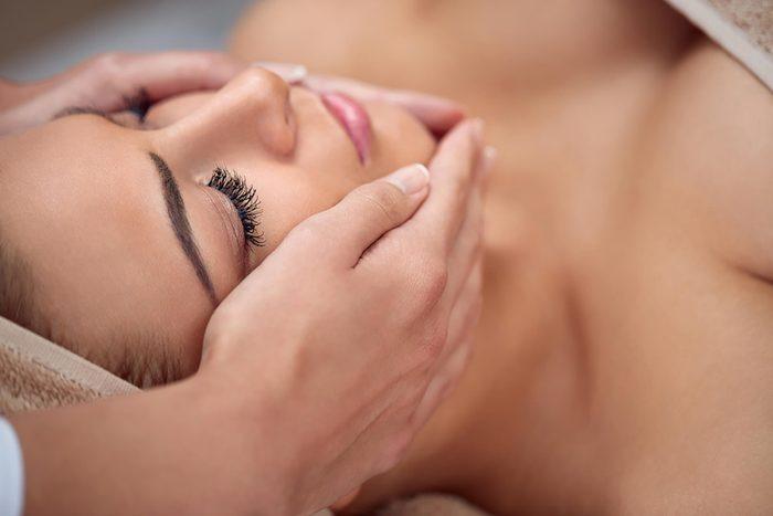 woman having her face massaged