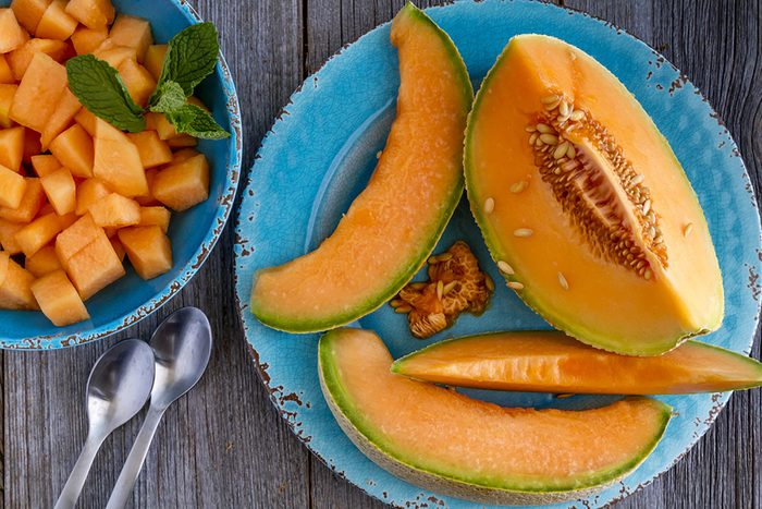 cantaloupe slices on a plate and chunks in a bowl