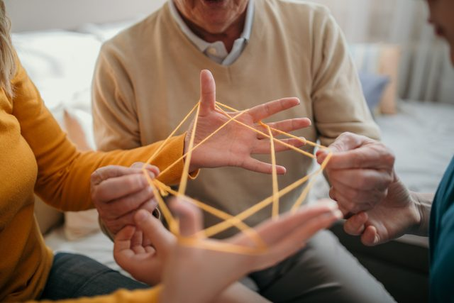 family playing cats cradle