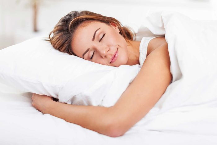 woman sleeping peacefully on her stomach
