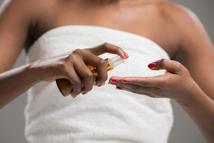 black woman applying Moisturizer