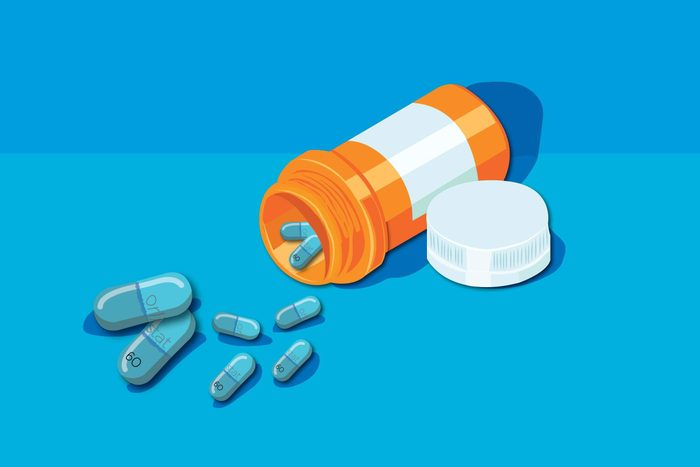 Illustration of pill bottle with orlistat capsules.