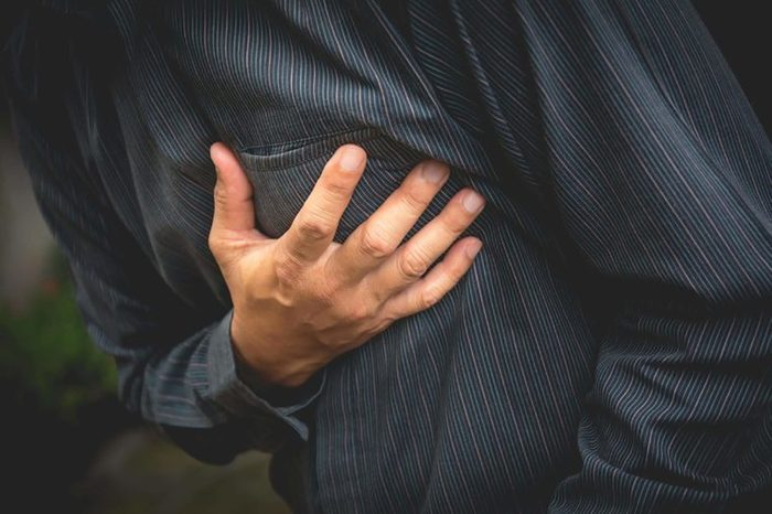 closeup of man clutching his chest