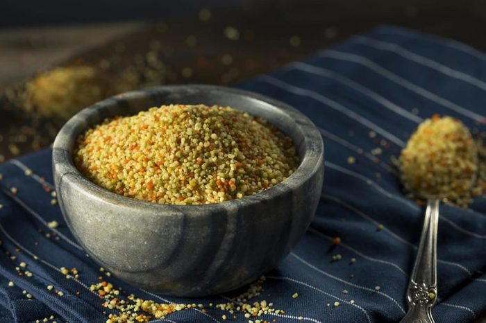 Couscous in bowl with spoon
