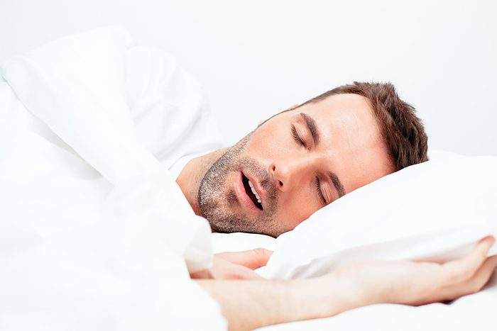 man on his side sleeping with his mouth open