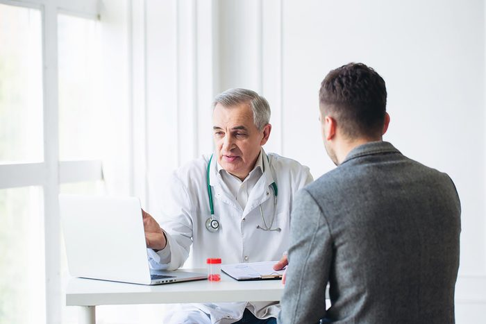Doctor discussing a diagnosis with a male patient