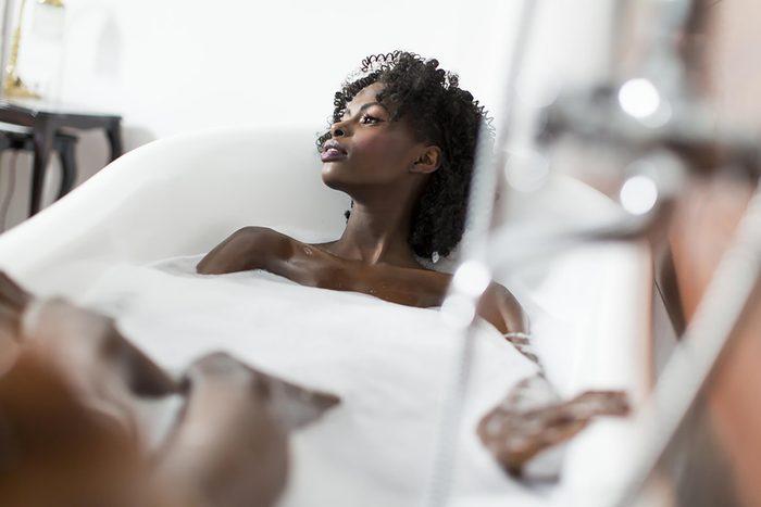 woman in epsom salt bath