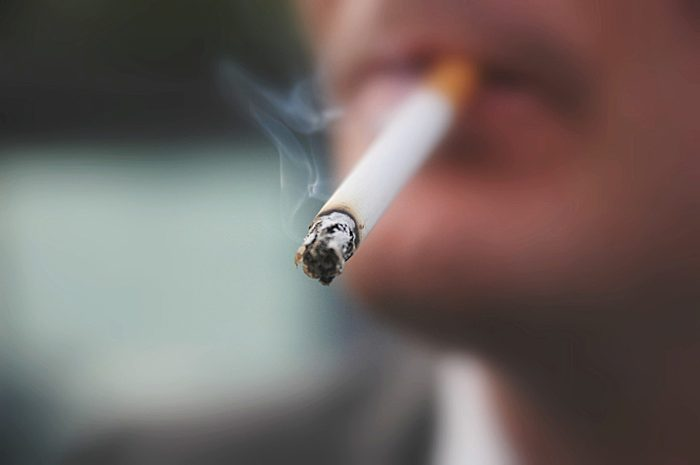 close up of cigarette in man's mouth