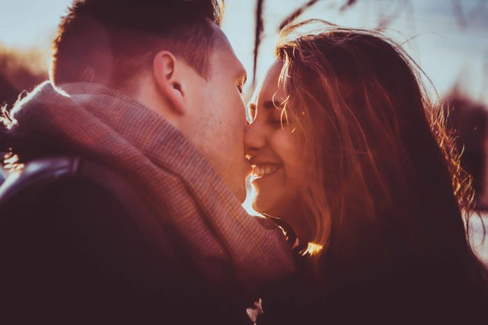 a couple kissing in winter outdoors