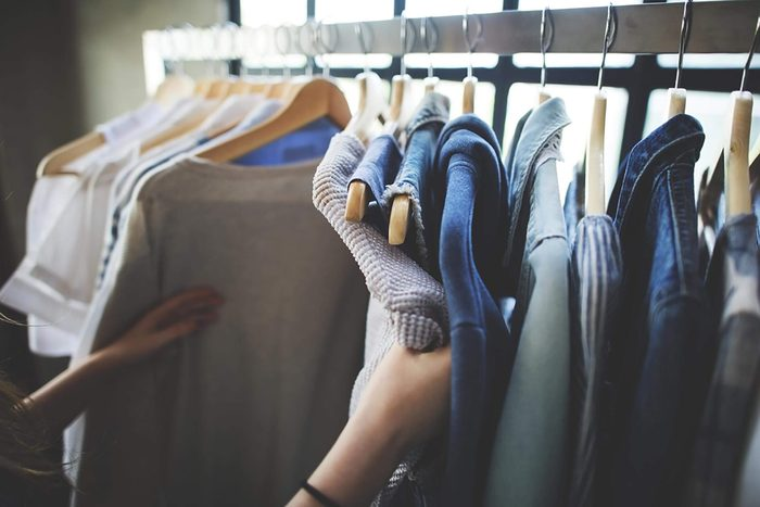hands on clothes on rack