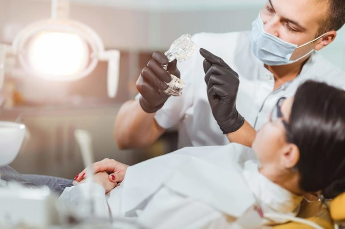 Dentist explaining device to patient