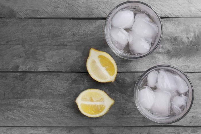 glasses of water with lemon slices